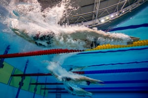 Adam Peaty enters the pool on his way winning the men's 100m Breaststroke final in a new world record time.