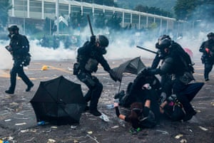 Baton-wielding police detain demonstrators in Sha Tin