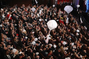 Candy is delivered from the rafters to the audience in balloons