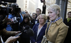 E. Jean Carroll, right, talks to reporters outside a courthouse in New York in March. To her right is her high-profile lawyer in the case, Robbie Kaplan.