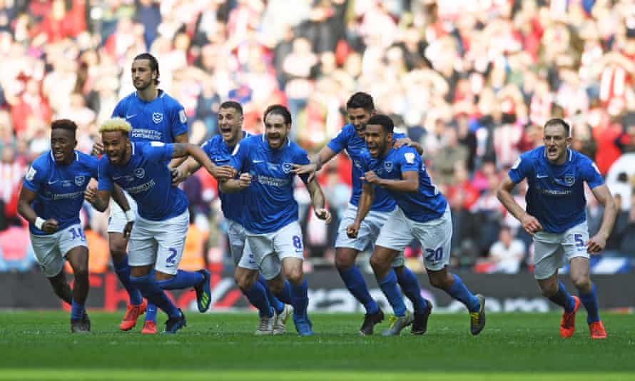 Portsmouth's players set off to celebrate with Oliver Hawkins.