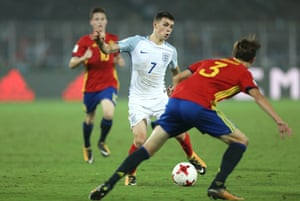 England's Philip Foden surges forward.