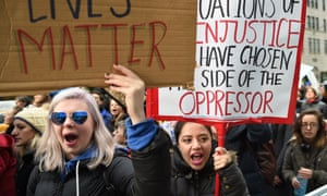 Woman rally as part of a nationwide protest against US President-elect Donald Trump outside of Trump Tower on December 12, 2016 in New York. / AFP PHOTO / TIMOTHY A. CLARYTIMOTHY A. CLARY/AFP/Getty Images