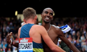 Mo Farah of Great Britain hands his shirt to Andrew Butchart after winning the men's 3,000m