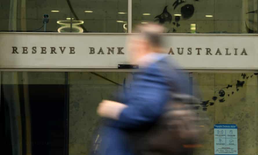 A pedestrian walks past the Reserve Bank of Australia (RBA) head office in Sydney, May 4, 2021.