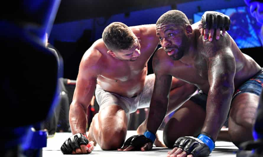 Alistair Overeem (left) consoles Walt Harris at the end of their fight