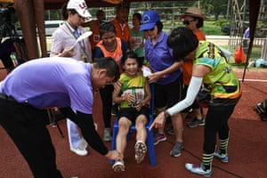A woman in the 65-70 age category resting after completing the 400-metre race
