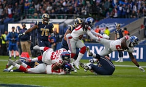 Landon Collins, right, scores a touchdown for the New York Giants during the NFL International Series match against Los Angeles Rams at Twickenham Stadium.