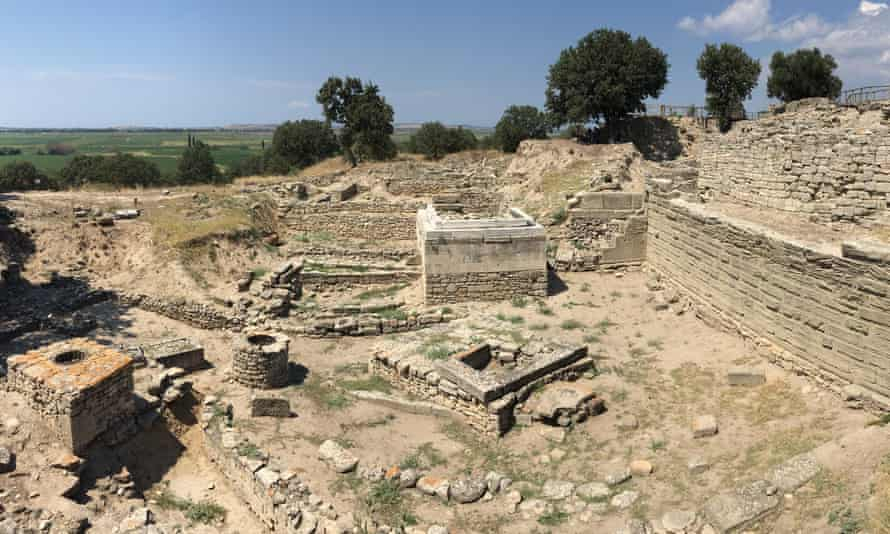 A panoramic view shows ruins of Homeric-era Troy and later Hellenistic structures