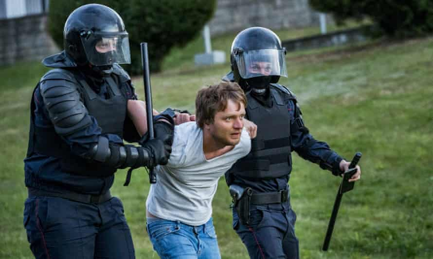 Riot police arresting a man in Minsk.