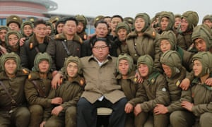 A photo released on Monday shows Kim Jong-un posing with the armed forces during drills in North Korea.