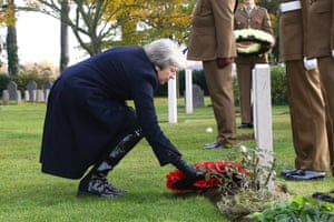 Theresa May lays a wreath at the St Symphorien military cemetery in Mons, Belgium