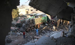 The scene the morning after a convoy delivering aid was hit by a deadly airstrike in Syria.