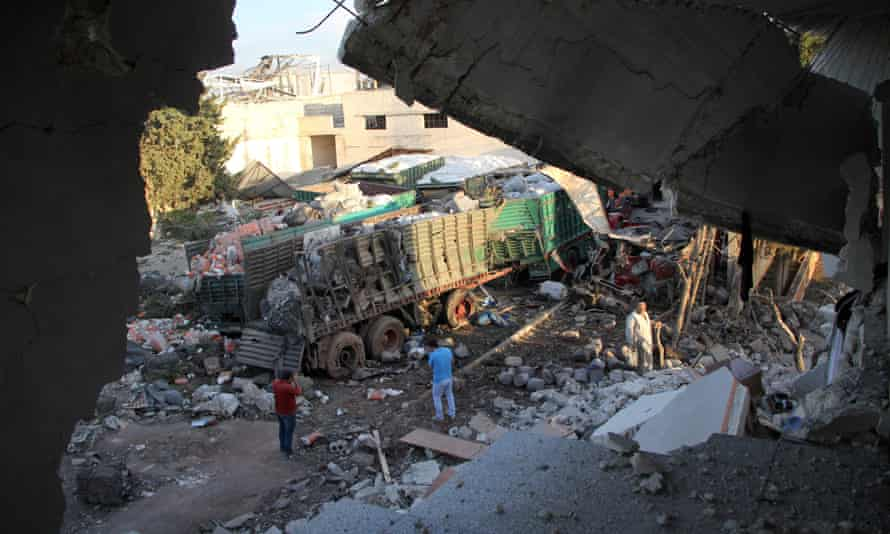 Aid is seen strewn across the floor the morning after a convoy delivering aid was hit by a deadly air strike.