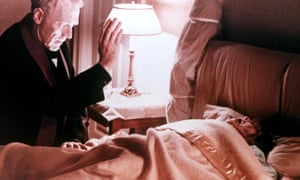 A still of Linda Blair and Max von Sydow from the 1973 film The Exorcist.