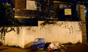 Rubbish is piled up on a street corner near where a suicide belt was found in a bin in Montrouge, near Paris, France, on 23 November.