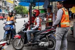 Drivers wait for business near the site of the fatal Bangkok brawl