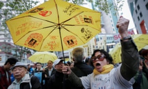 Pro-democracy protesters and pro-China protesters hold demonstrations during elections in Hong Kong<br>epaselect epa05871066 A pro-democracy supporter chants slogans while holding a yellow umbrella, the symbol of the pro-democracy movement, during a rally near the Convention Center in Hong Kong, China, 26 March 2017. Hong Kong is choosing its next leader on 26 March but ordinary people do not have a say, as only a 1,194-member panel dominated by pro-Beijing elites chooses among three candidates, in a system that was at the root of massive 2014 pro-democracy protests.  EPA/STR
