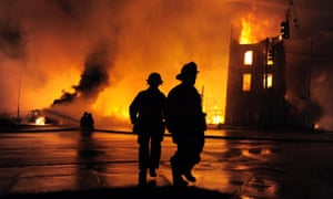 A fire rages as emergency services try to cope