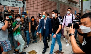 Martin Lee (C) leaves a police station in Hong Kong on 18 April after being arrested and accused of organising an unlawful assembly last August.