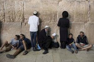 Orthodox Jews attend a night-long prayer to mark Tisha B'av at the Western Wall
