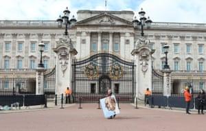 Buckingham Palace. Artist Kaya Mar holds a portrait he has painted of the Duke of Edinburgh