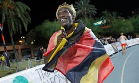 Joshua Cheptegei celebrates after running 26min 11sec to set the world record for the men's 10,000m in Valencia.