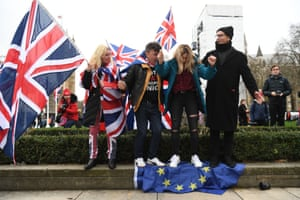 Brexit supporters stand on the EU flag in Parliament Square