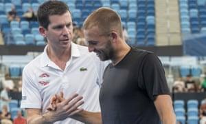 Britain's captain Tim Henman congratulates Dan Evans after his win over Radu Albot.