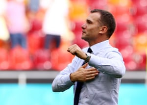 Ukraine coach Andriy Shevchenko celebrates with the fans after the match.