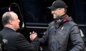 Jurgen Klopp and Rafael Benitez greet one another before Saturday's game.