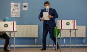 Mongolian Prime Minister Oyun-Erdene Luvsannamsrai, wearing a protective face mask, casts his vote at a polling station in Ulaanbaatar, Mongolia.