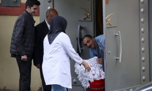 Saudi officials and cleaning workers enter the Saudi consulate in Istanbul, Turkey.