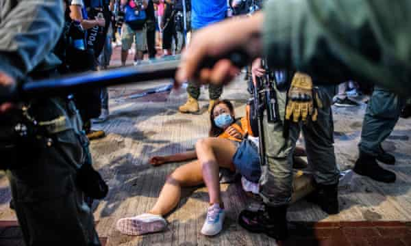 Police detain demonstrators in Hong Kong's Causeway Bay district