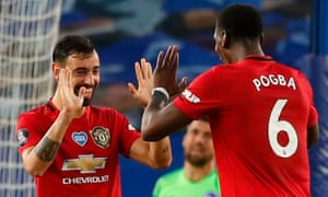 Bruno Fernandes celebrates scoring Manchester United's second goal with his teammate Paul Pogba in the win at Brighton.