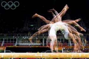A multi exposure photo of Switzerland's Giulia Steingruber competing on the balance beam.
