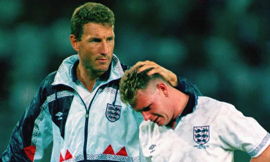 Terry Butcher (left) consoles Paul Gascoigne after England's shootout defeat to West Germany in 1990.