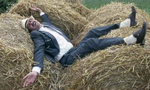 john cleese on a bail of hay