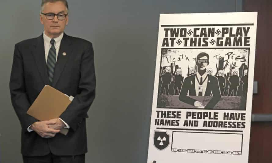 US attorney Brian Moran stands next to a poster that was mailed earlier in the year to the home of Chris Ingalls, an investigative reporter with KING-TV in Seattle, during a news conference on 26 February.