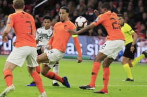 Virgil van Dijk cannot prevent Serge Gnabry from scoring for Germany during the Netherlands' 3-2 defeat in March.