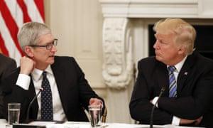 Apple CEO Tim Cook talks to Donald Trump. '