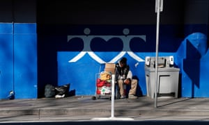 A person sits outside the MSC South homeless shelter in San Francisco.