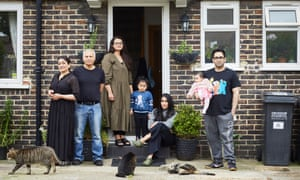 Zara Sehr (seated) with (l to r) Rubina, Arshad, Huraira, Imaan, Noor, Faisal and three of their cats.