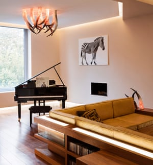 'I believe God wanted me to be in this house': Alexander McQueen's golden ostrich-leather sofa and Tinie Tempah's grand piano.