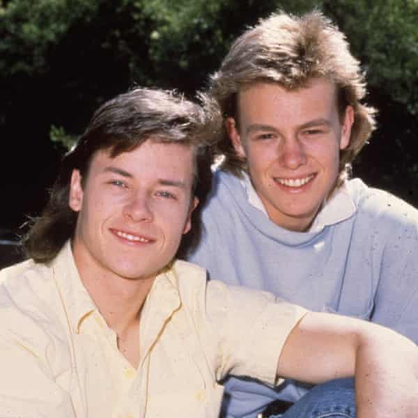 Guy Pearce as Mike Young and Jason Donovan as Scott Robinson in Neighbours