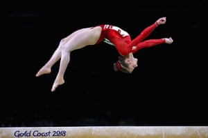 England's Kelly Simm competes on the beam during the women's individual all-around final.