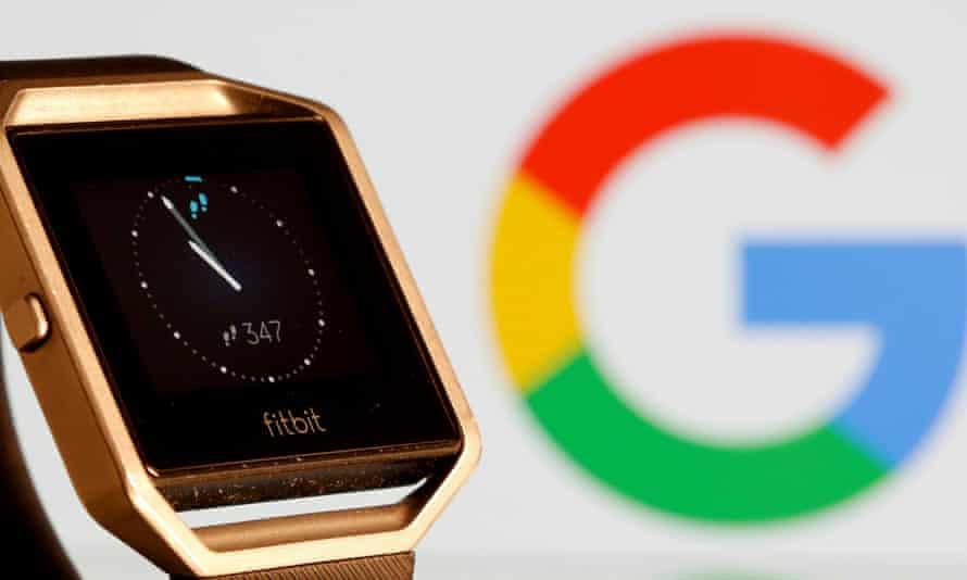 Fitbit watch next to Google logo