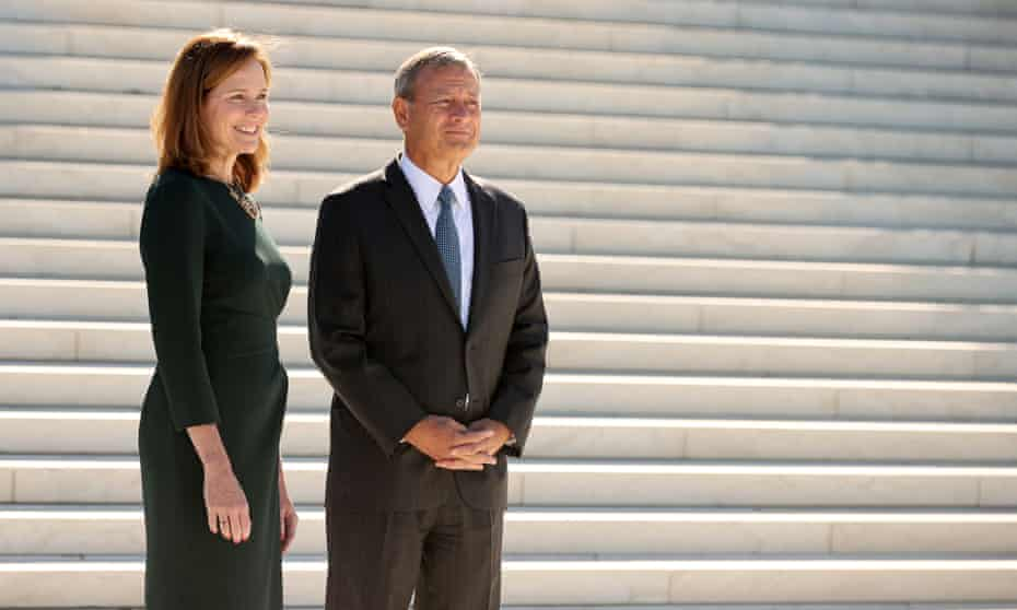 John Roberts with Amy Coney Barrett by the supreme court last week.