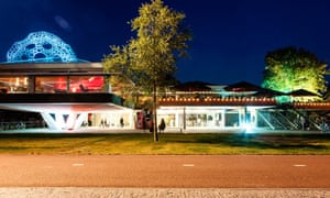 Exterior, wide shot of Tolhuistuin club in Amsterdam, taken at night.