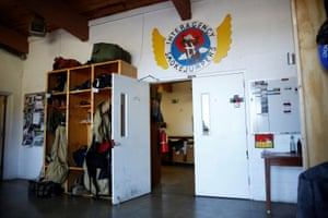 The logo of West Yellowstone smokejumpers on the wall above a set of doors at the base.